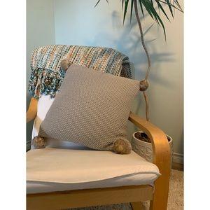 Soft tan knit pillow with soft faux fur Pom poms